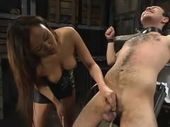 Asian hussy Annie Cruz enjoys torturing Sir C in a basement