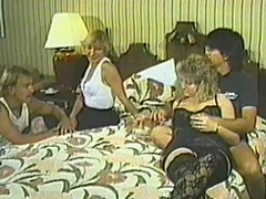 Retro video with kinky four swinger couples gender in a bedroom