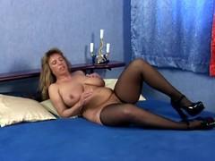 Mature slut Brenda moans loudly while masturbating her cunt indoors