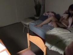 Japanese brunette gets filmed masturbating